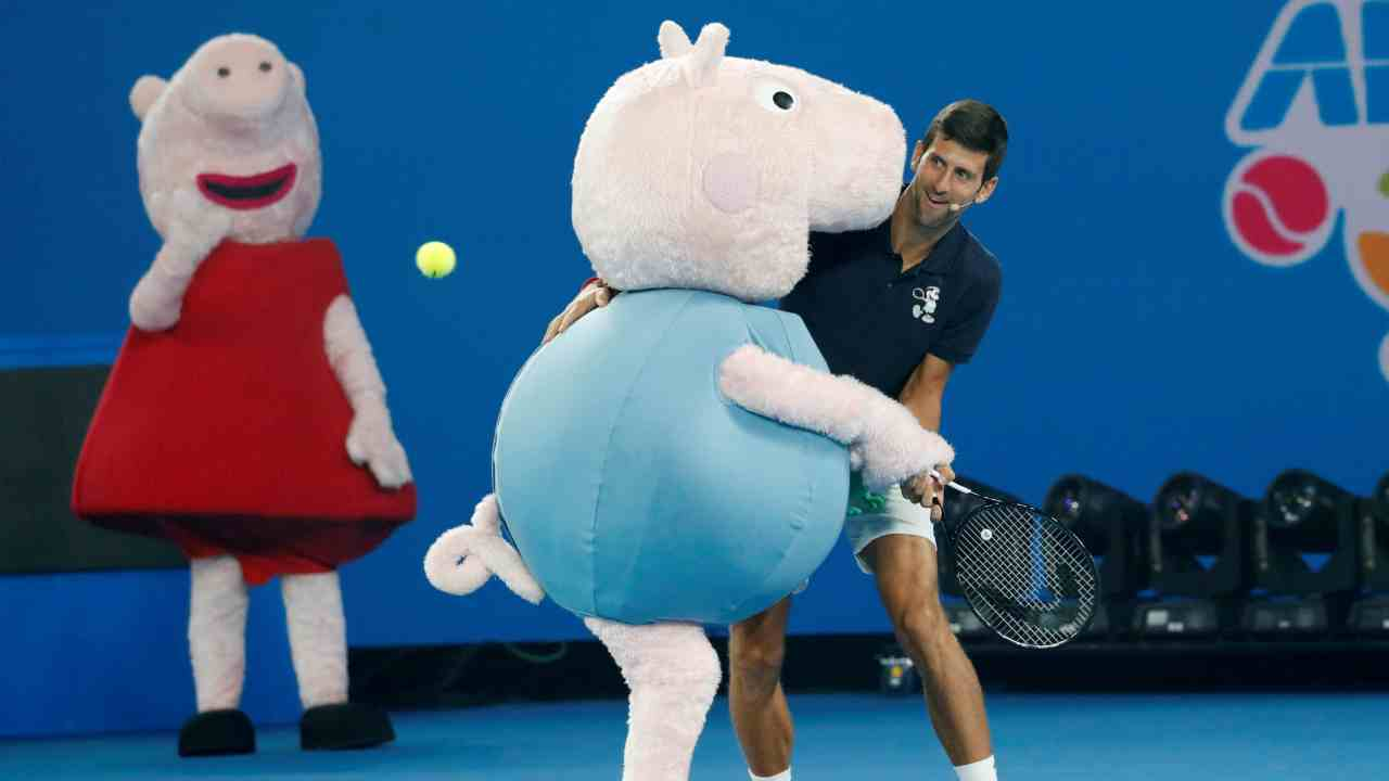 Australian Open, Melbourne, Australia | Serbia's Novak Djokovic with Peppa Pig characters at Kids Tennis Day. (Reuters)