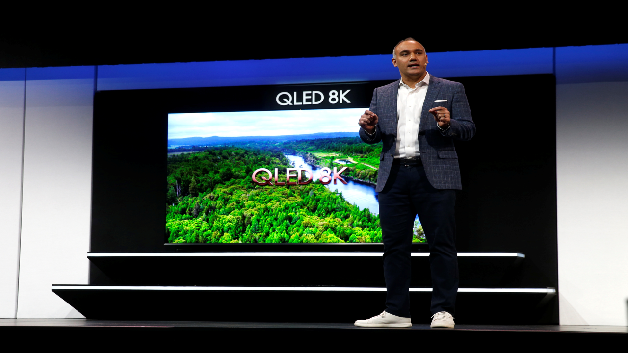 Dave Das, Senior Vice-President of consumer electronics product marketing at Samsung Electronics America, speaks by a 98-inch, QLED 8K smart television during a news conference at CES 2019. (Image: Reuters)
