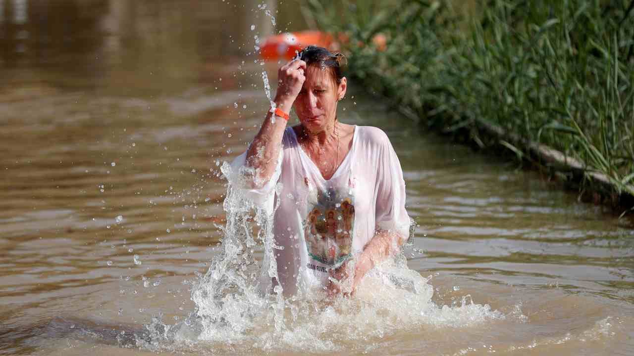 A pilgrim takes a dip in the waters of the Jordan River during a baptism ceremony at the Qasr el-Yahud site, near Jericho, in the Israeli-occupied West Bank. (Reuters)