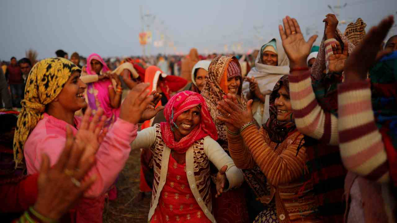 "Devotees sing and dance after taking a holy dip at Sangam, the confluence of the Ganges, Yamuna and Saraswati rivers, during ""Kumbh Mela"", or the Pitcher Festival, in Prayagraj. (Reuters)"