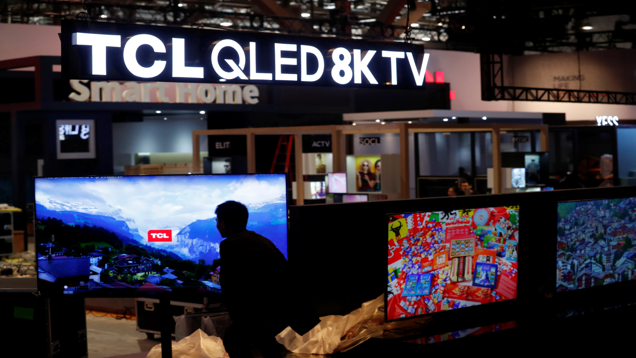 QLED 8K televisions are displayed at the TCL booth in the Las Vegas Convention Center as workers prepare for CES 2019. (Image: Reuters)