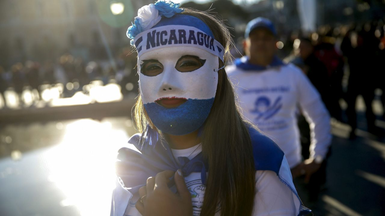 A woman wears a mask with the colors of the Nicaraguan flag during a protest against the Nicaraguan government in Madrid, Spain. Nicaragua has been rocked by anti-government protests since April, which have left more the 500 dead and hundreds more in prison, according to local human rights groups. (AP/PTI)
