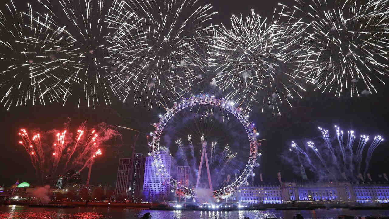 Fireworks explode over the London Eye during the New Year's eve celebrations after midnight in London. (Image: AP/PTI)