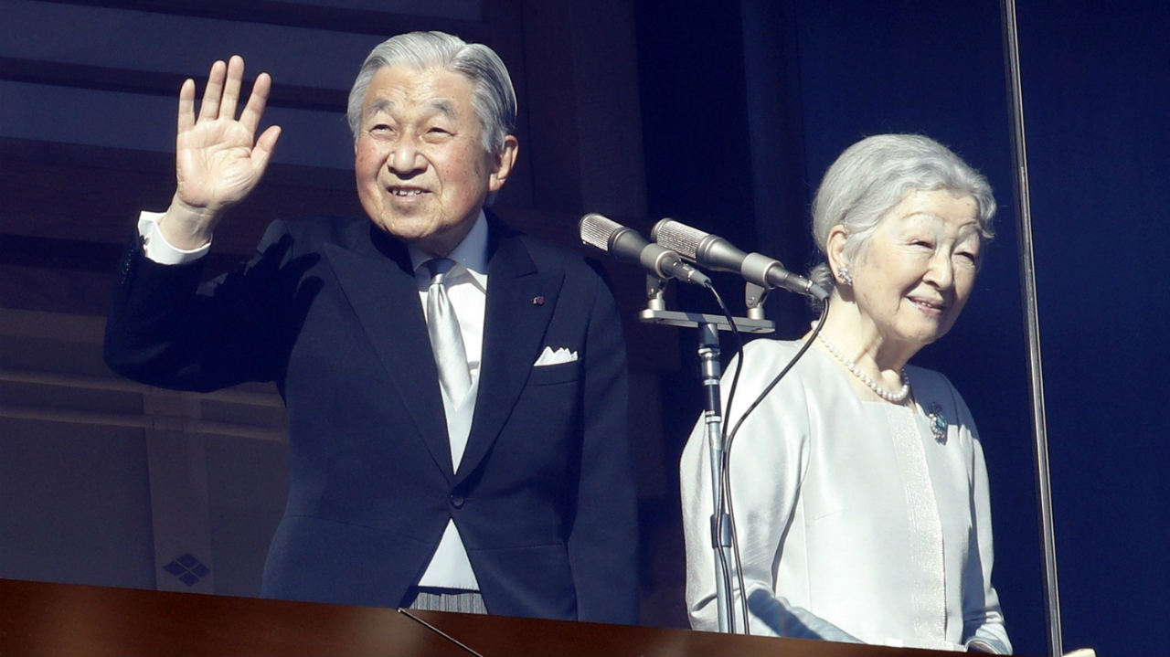 Japan's Emperor Akihito and Empress Michiko greet to well-wishers from the bullet-proofed balcony during their New Year's public appearance with family members at Imperial Palace in Tokyo. (Image: AP/PTI)