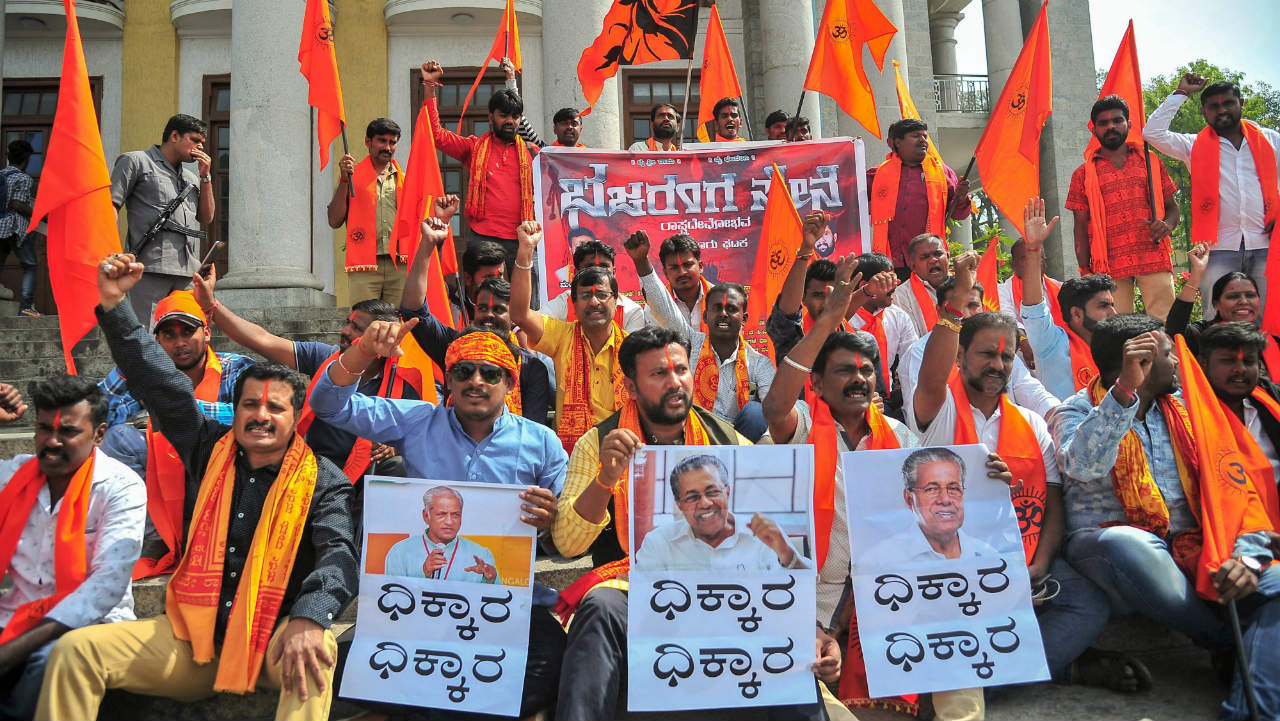 Members of Bajrang Dal hold placards and raise slogans against Kerala Government on the Sabarimala issue, in Bengaluru. (Image: PTI)