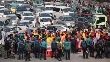 Bangladesh factory owners threaten to cut off pay to protesting workers