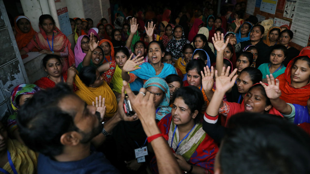 The garment workers shout as they protest for higher wages in Dhaka, Bangladesh. (Image: Reuters)