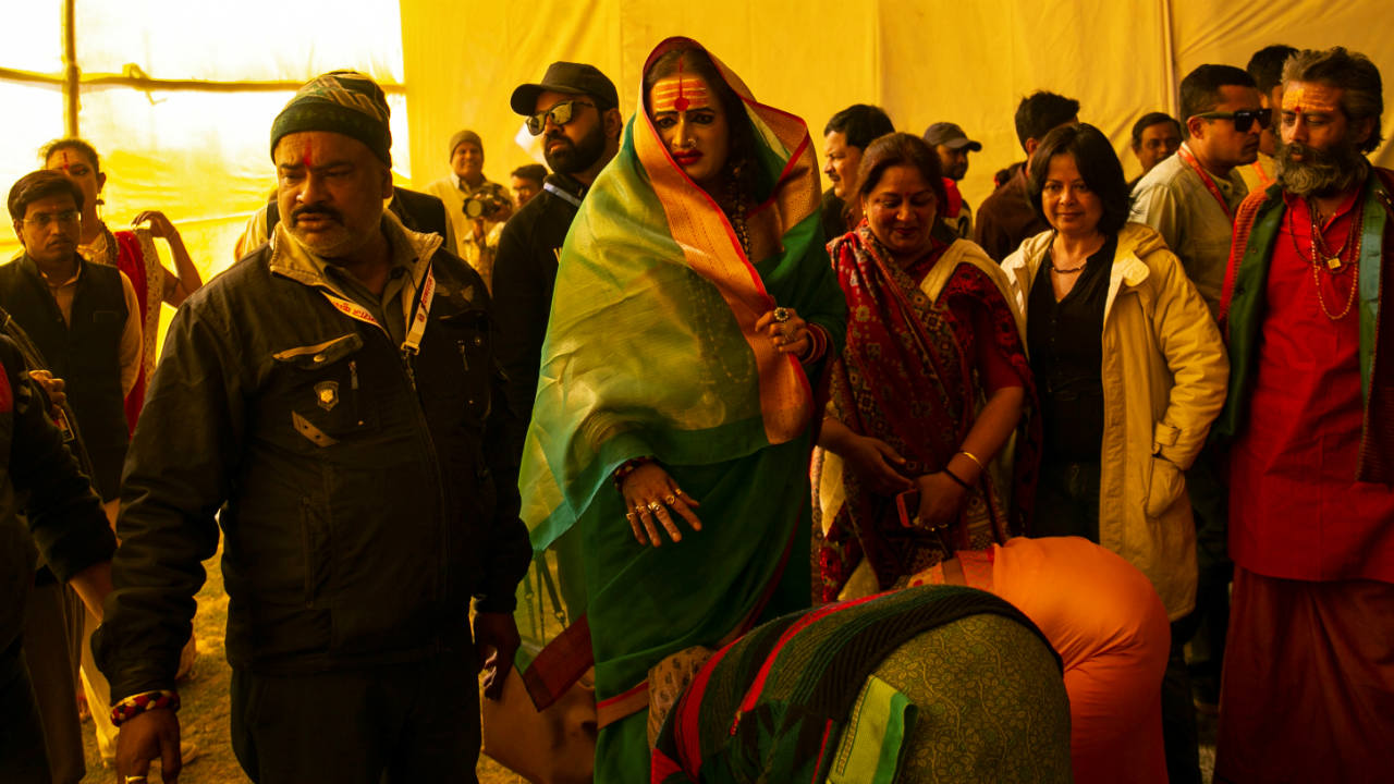 """Laxmi Narayan Tripathi, chief of the """"Kinnar Akhara"""" congregation for transgender people blesses her followers during """"Kumbh Mela"""", or the Pitcher Festival, in Prayagraj, previously known as Allahabad. (Image: Reuters)"""