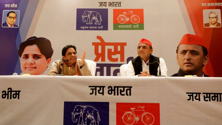 The Bahujan Samaj Party (BSP) chief Mayawati (L) speaks as Akhilesh Yadav, chief of Samajwadi Party (SP), looks on during a joint news conference to announce their alliance for the upcoming national election, in Lucknow. (Image: Reuters)