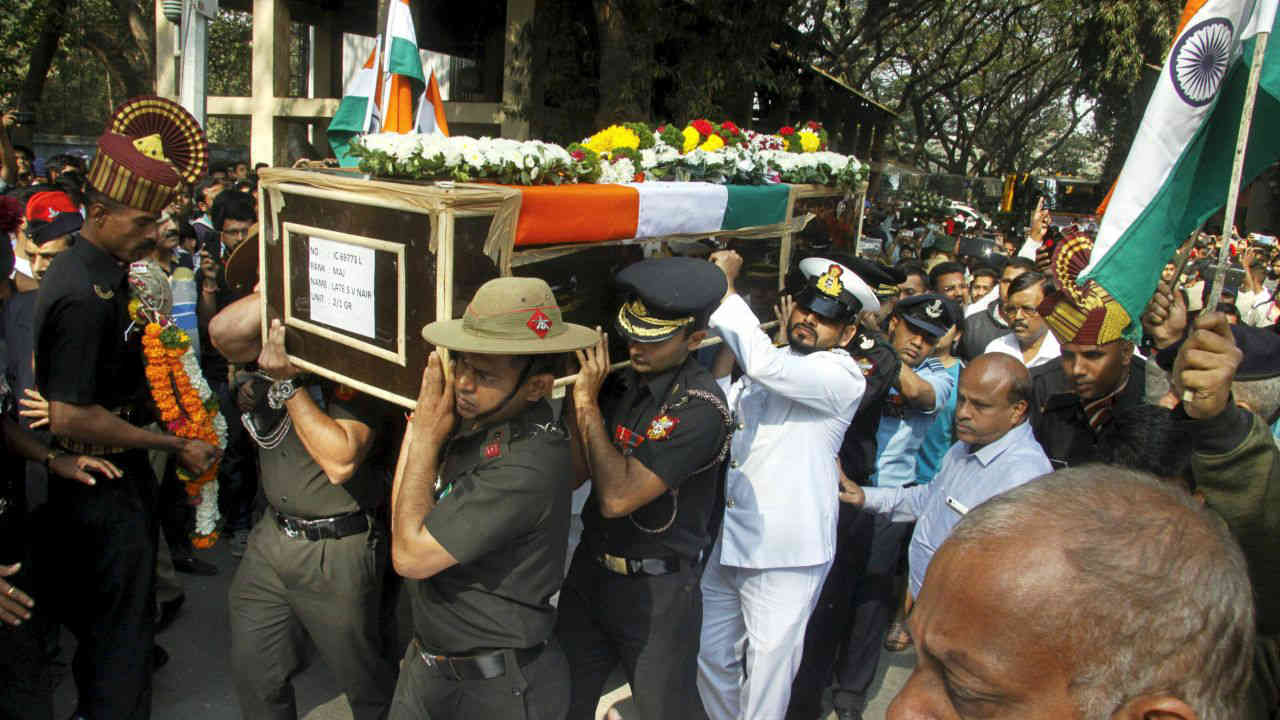 Tri-services personnel carry the mortal remains of Major Shashidharan V Nair during his funeral ceremony, in Pune. Nair was killed in an IED blast along the LoC in Rajouri district of Jammu and Kashmir. (PTI)