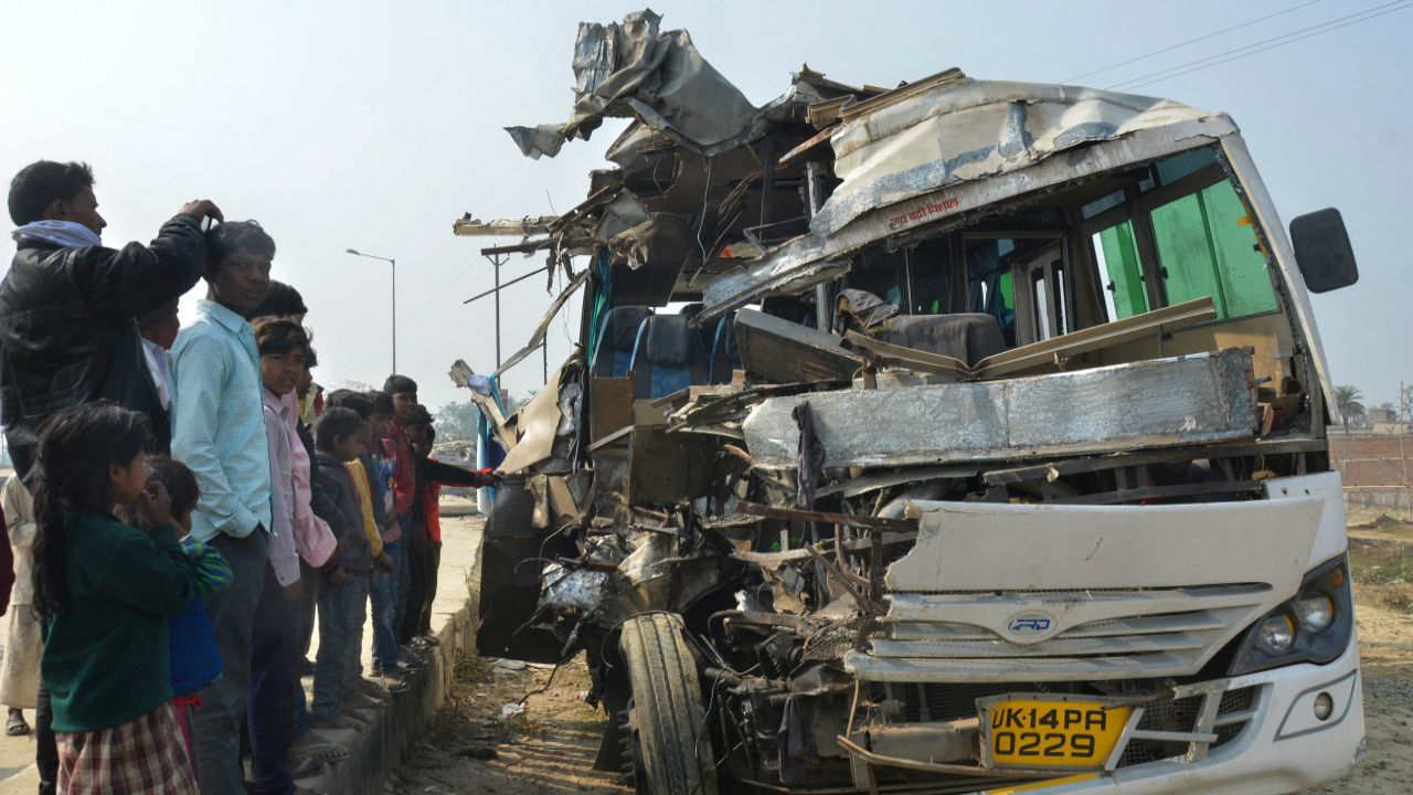 People look on at a mangled tourist bus which collided with a truck on Sitamarhi-Muzaffarpur NH-77, in Sitamarhi. At least two people died and several were injured. (PTI)
