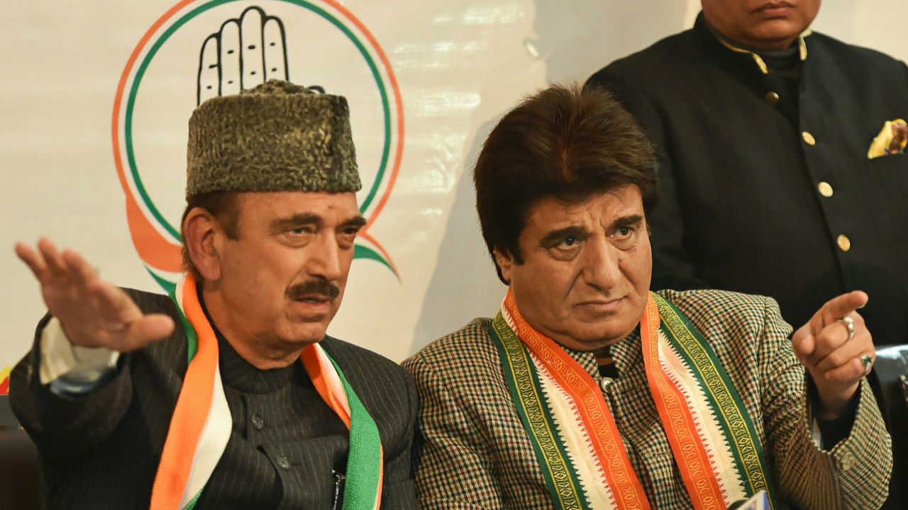 Senior Congress leader and party general secretary Ghulam Nabi Azad addresses as UP Congress chief Raj Babbar looks on during a press conference, in Lucknow. (PTI)