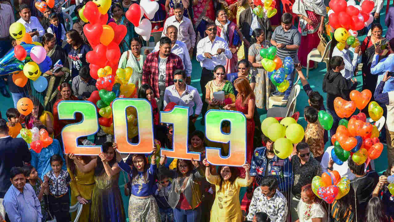 People celebrate the New Year 2019 outside a church in Ahmedabad. (Image: PTI)