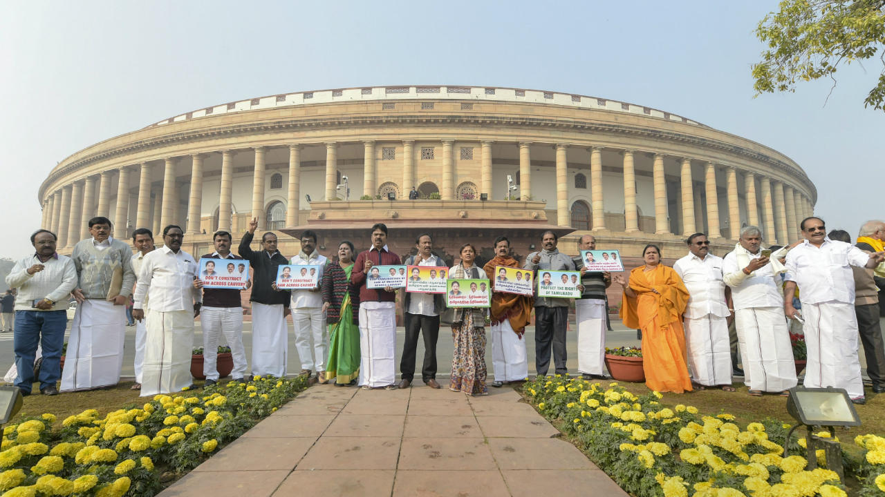 All India Anna Dravida Munnetra Kazhagam (AIADMK) members stage a protest against construction of new dams over Cauvery River during the Winter Session of Parliament, in New Delhi. (Image: PTI)