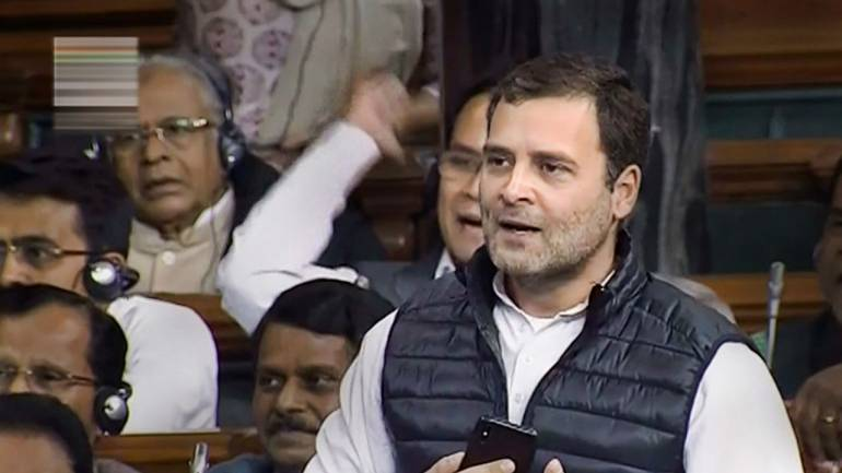 Congress President Rahul Gandhi speaks in the Lok Sabha during the discussion on Rafale deal issue at Parliament in New Delhi. (Image: LSTV screengrab via PTI)