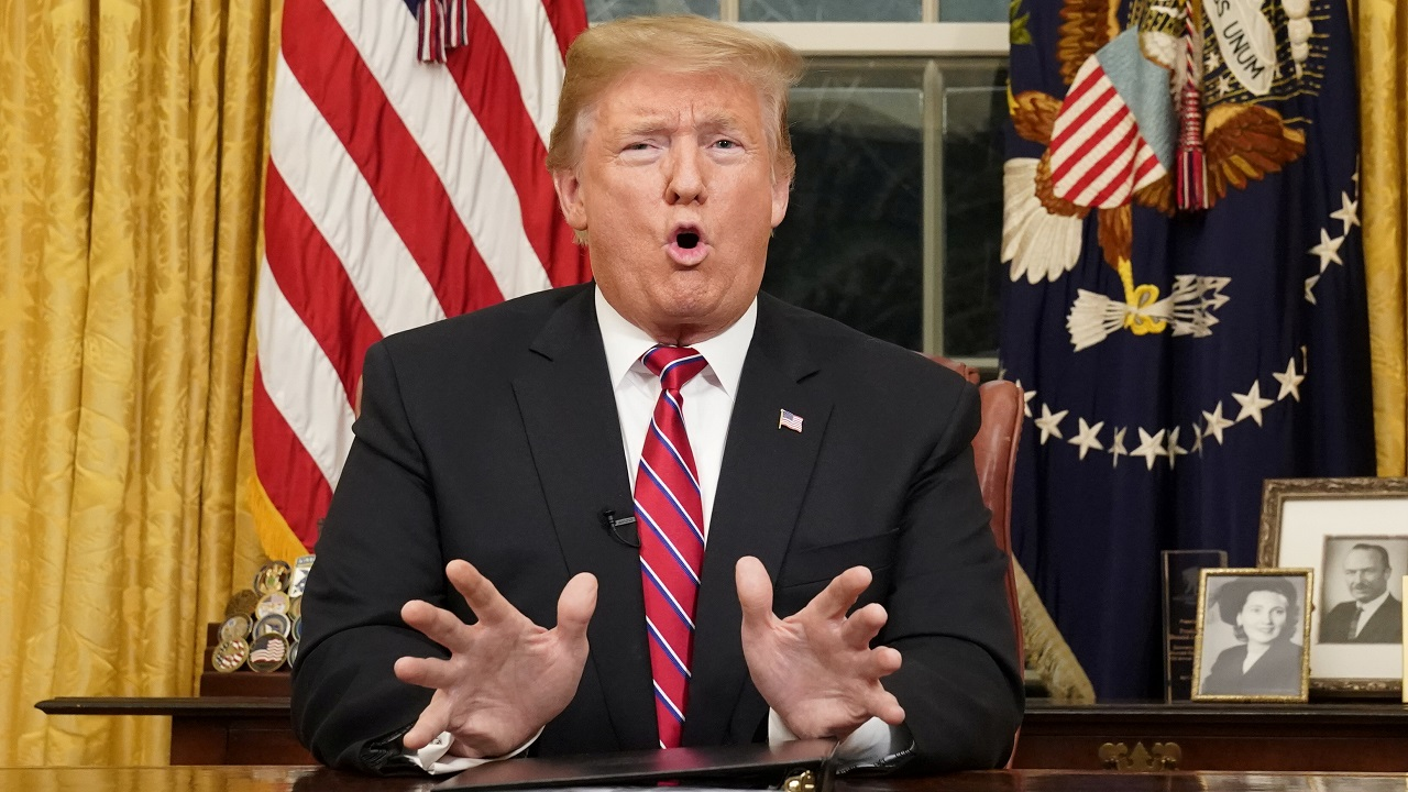 US President Donald Trump delivers a televised address to the nation from his desk in the Oval Office about immigration and the southern US border on the 18th day of a partial government shutdown at the White House in Washington. (Image: Reuters)