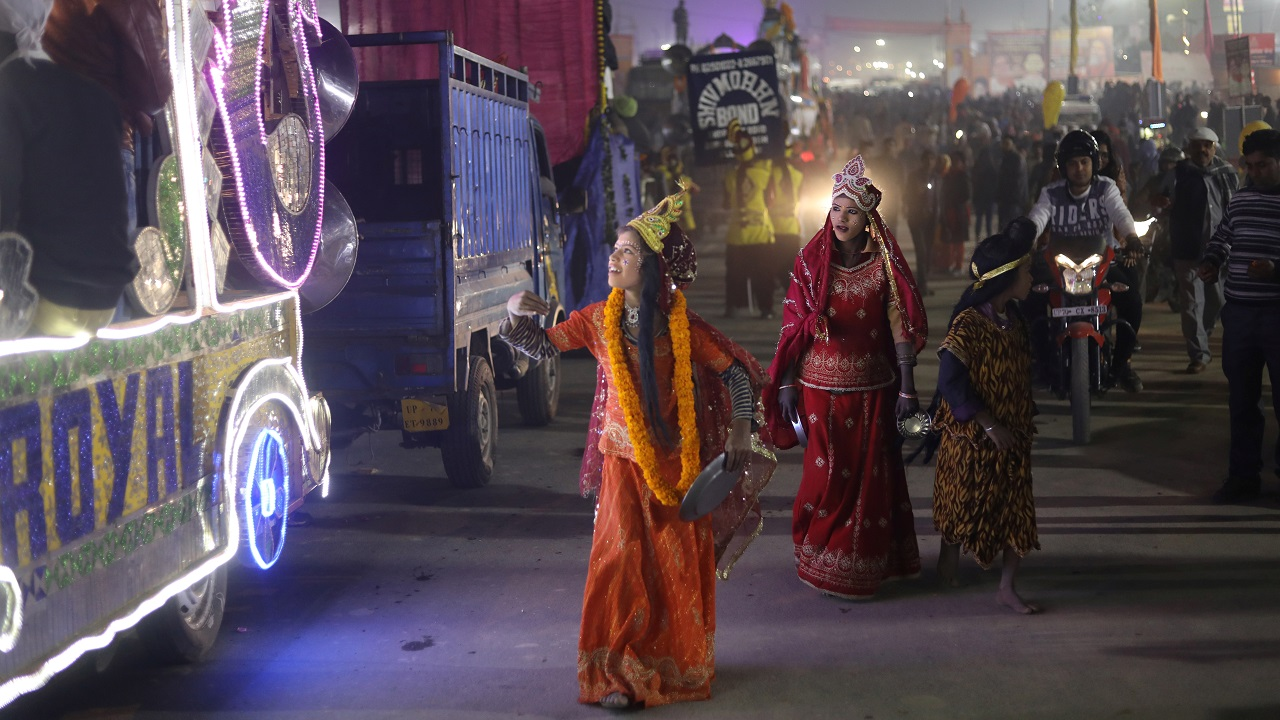 "Children dressed as ""Goddesses"" follow a religious procession ahead of the ""Kumbh Mela"" in Prayagraj. (Image: Reuters)"