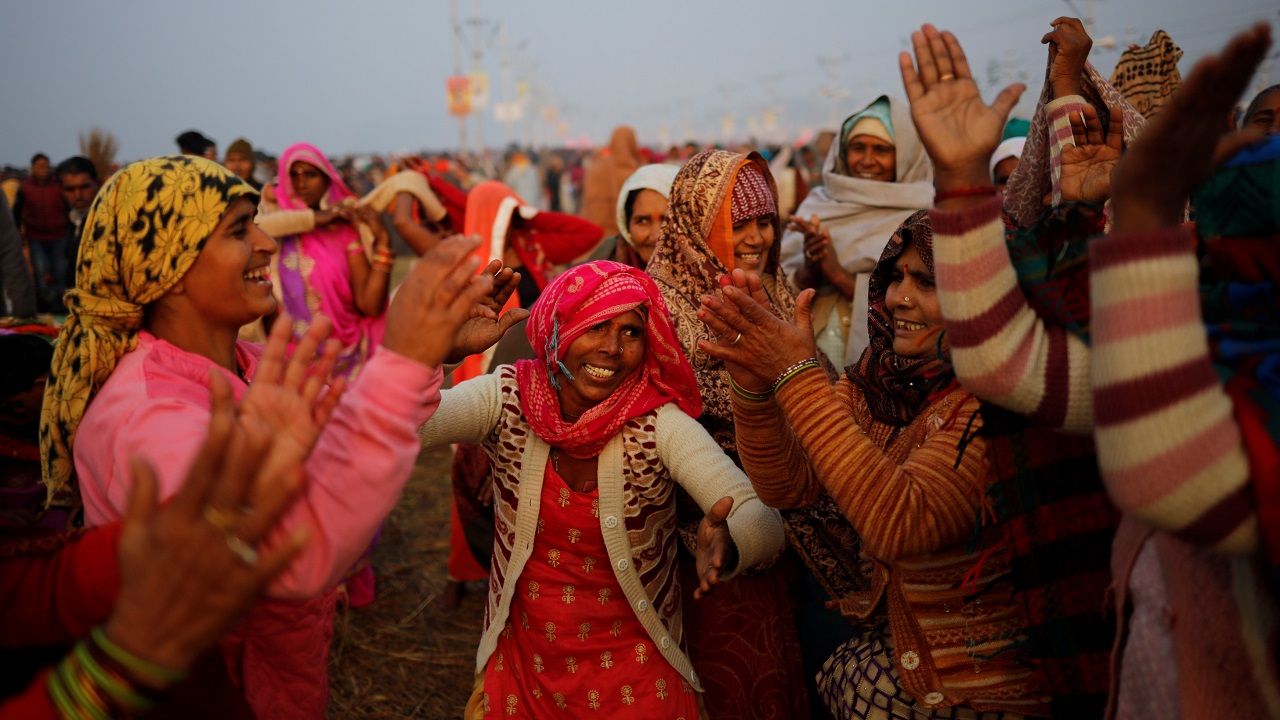 "Devotees sing and dance after taking a holy dip at Sangam, the confluence of the Ganges, Yamuna and Saraswati rivers, during ""Kumbh Mela"" in Prayagraj. (Image: Reuters)"