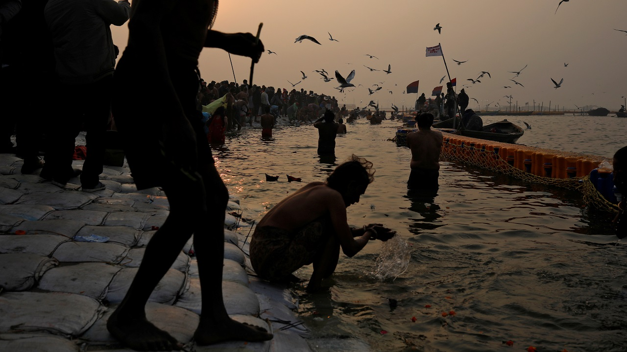 "Devotees take a holy dip at Sangam, the confluence of the Ganges, Yamuna and Saraswati rivers, during ""Kumbh Mela"" in Prayagraj. (Image: Reuters)"
