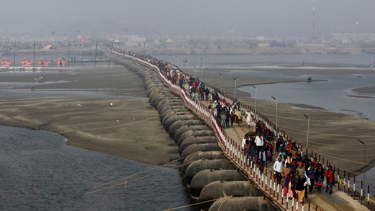 "Devotees leave after taking a holy dip during ""Kumbh Mela"" in Prayagraj. (Image: Reuters)"
