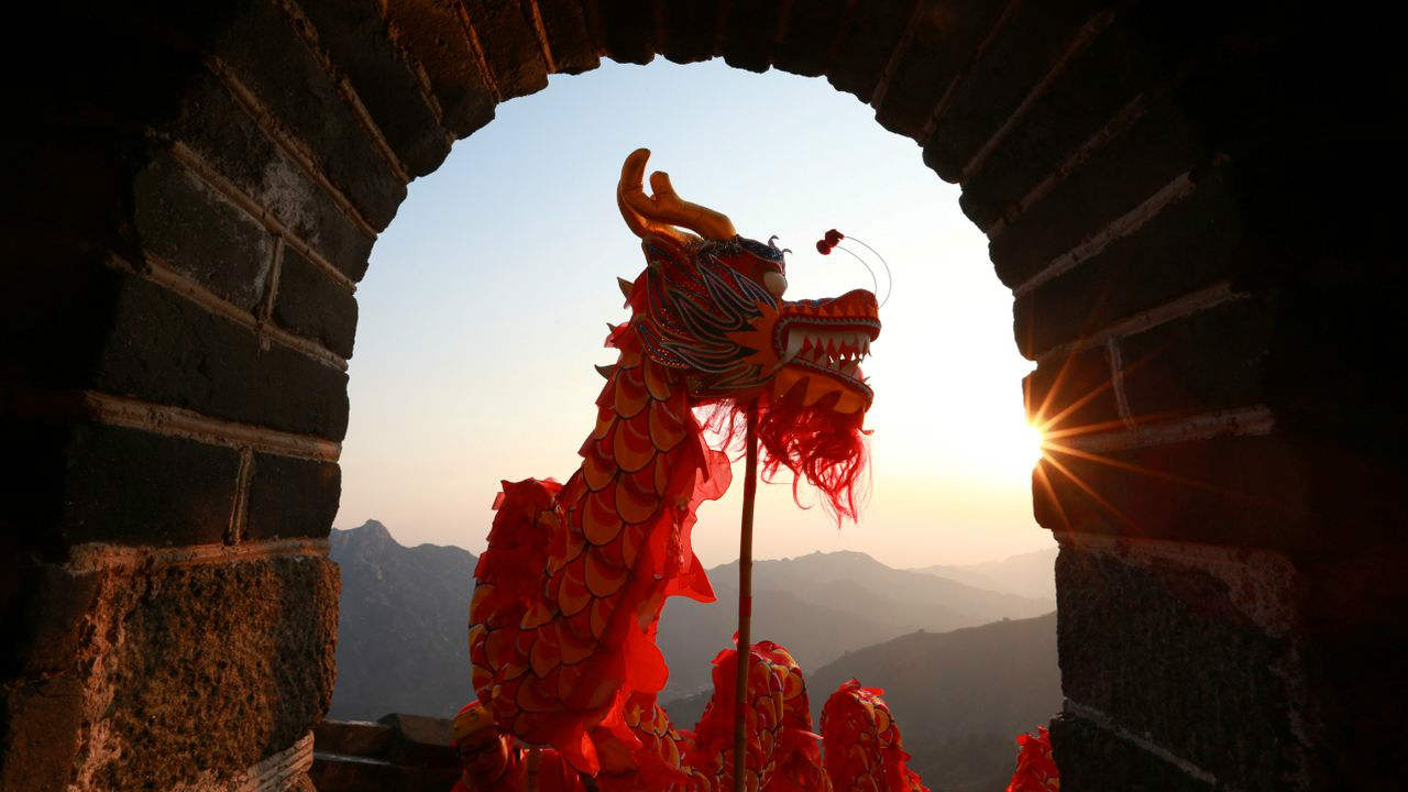 Performers take part in a dragon dance during sunrise at the Mutianyu section of the Great Wall of China in Huairou district of Beijing, China. (Image: Reuters)