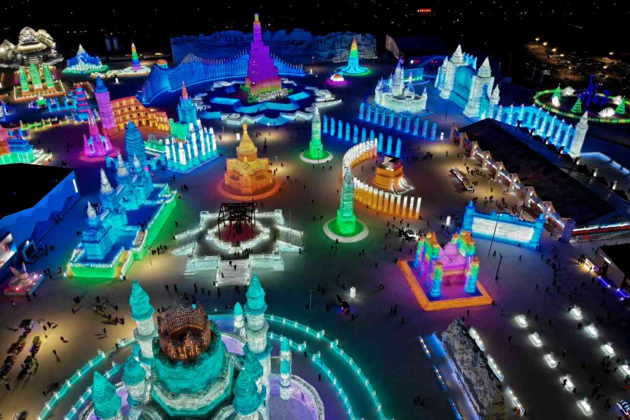 Apart from the gigantic illuminated ice castles, the festival also boasts of an exquisite snow Buddha statue a 3D light show and the 340-meter-long Northern Lights-themed ice slides. (Image: AP)