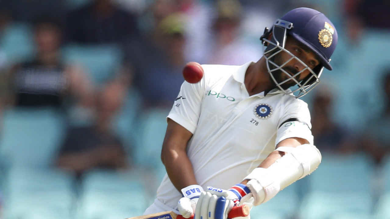 Ajinkya Rahane put up a 48-run partnership along with Pujara before he perished to a short ball from Mitchell Starc. A bouncer from the Aussie pacer kissed Rahane's gloves to go straight to Paine. The batsman made just 18 runs off 55 balls. India were 228/4 at the loss of Rahane's wicket. (Image: AP)