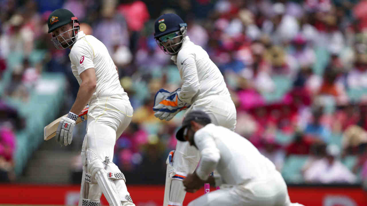 Shaun Marsh struggled to get going and Jadeja put him out of his misery as he got the batsman to nick a delivery to first slip. India's vice-captain Ajinkya Rahane standing at first slip accepted the catch gleefully. (Image: AP)