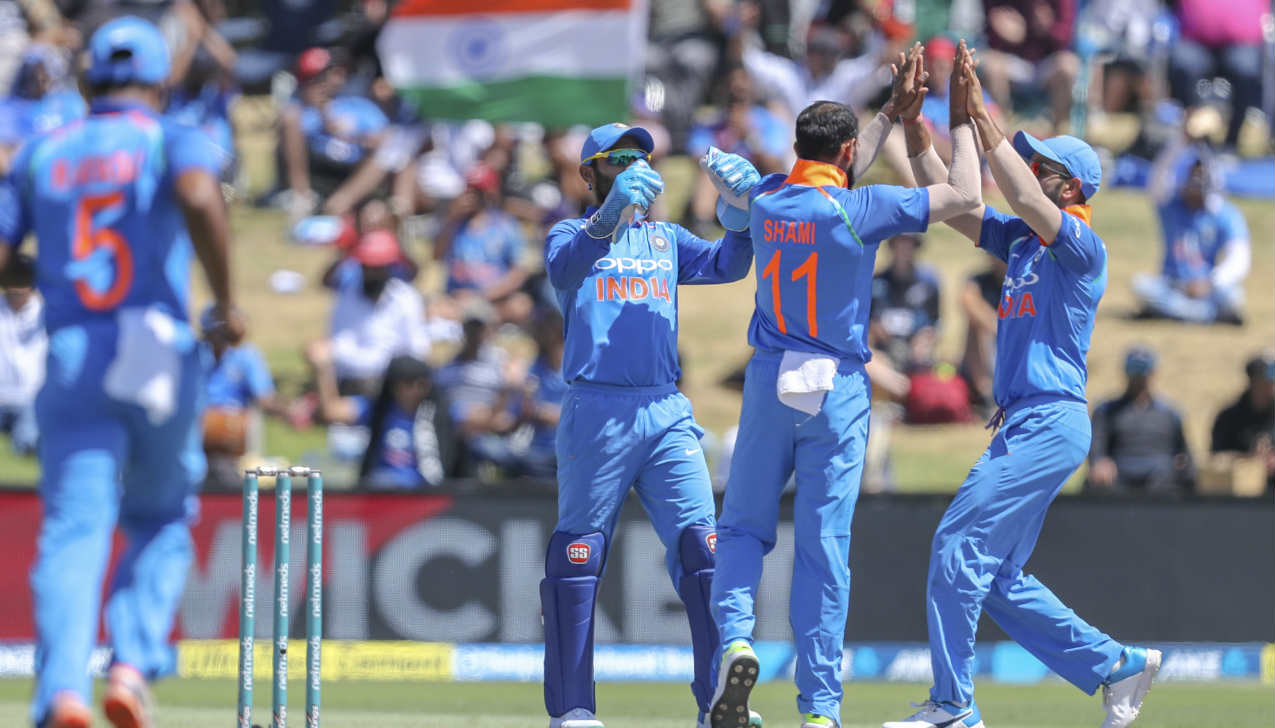 The opening bowling pair of Mohammed Shami and Bhuvneshwar Kumar again gave India a great start as they dismissed Colin Munro and Martin Guptill cheaply. While, Munro was caught at first slip by Rohit Sharma, Guptill was caught by stand-in keeper Dinesh Karthik. NZ were 26-2 when Guptill walked back. (Image: AP)