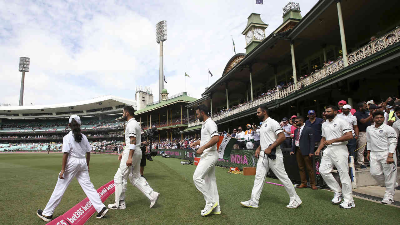 On the morning of Day 1 of the fourth Test being played at the Sydney Cricket Ground, Indian skipper Virat Kohli won the toss and had no hesitation in opting to bat first. Both India and Australia made two changes in their playing XI. Rohit Sharma and Ishant Sharma made way for KL Rahul and Kuldeep Yadav. Aussies left out Aaron Finch and Mitchell Marsh in favour of Peter Handscomb and Marnus Labuschagne. (Image: AP)