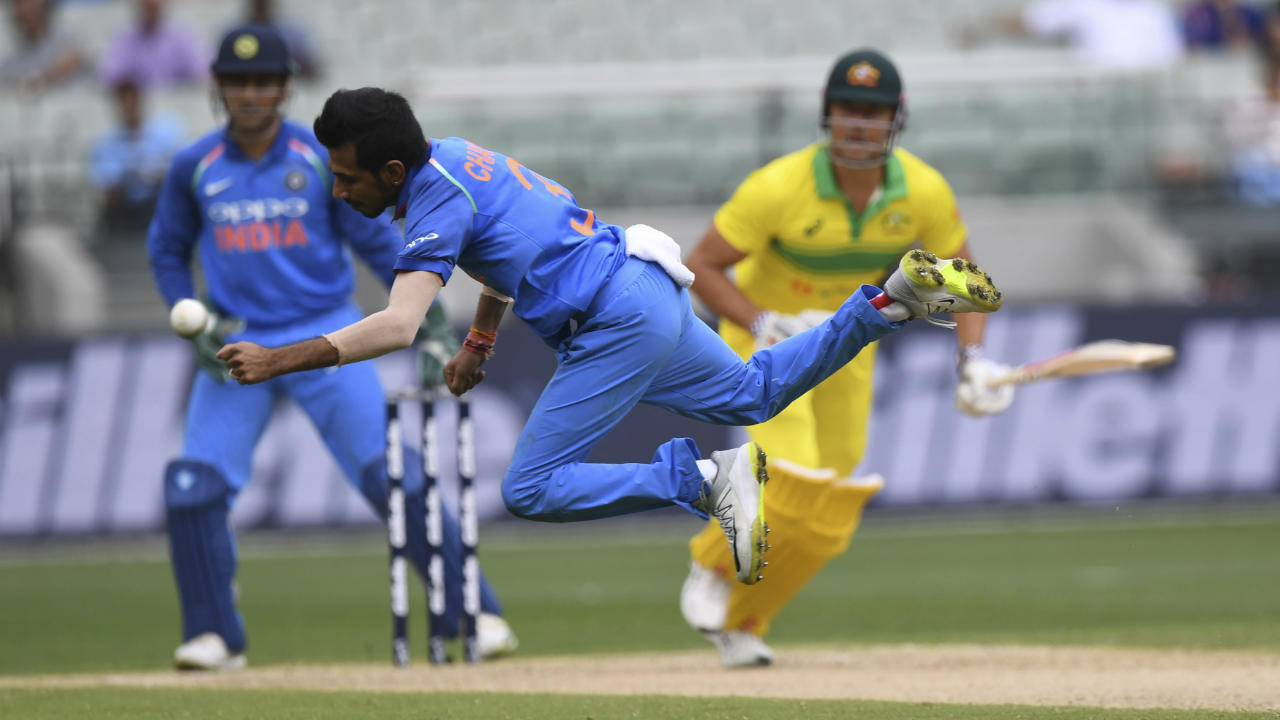 Glenn Maxwell along with Marcus Stoinis had barely managed to 22 runs together when Stoinis edged a delivery from Chahal to Rohit Sharma standing at first slip. Australia were five down at 123. (Image: AP)