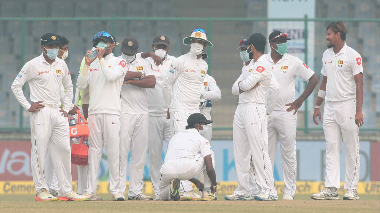 Pollution stops play | In a first recorded instance that play was stopped due to toxic smog, India vs Sri Lanka Test match was halted several times on Day 2 as players struggled to breathe. A majority of the Sri Lankans emerged wearing anti-pollution masks after lunch and their pacers had to receive medical treatment twice during the game as they struggled to complete their overs. Sri Lanka eventually ran out of healthy players to take the field forcing Virat Kohli to declare at 536/7. (Image: Reuters)