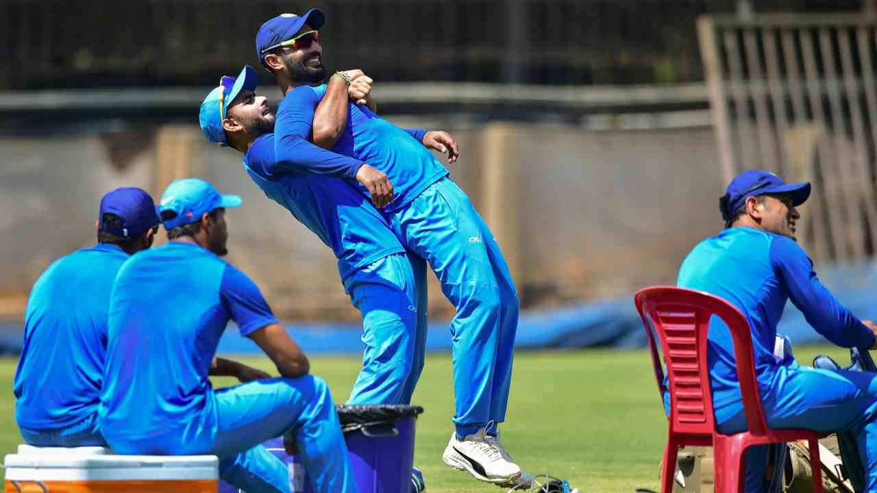 Wicket-keepers Rishabh Pant and Dinesh Karthik and other teammates during a practice session ahead of the 2nd T20 cricket match against Australia, at Chinnaswamy Stadium in Bengaluru. (Image: PTI)