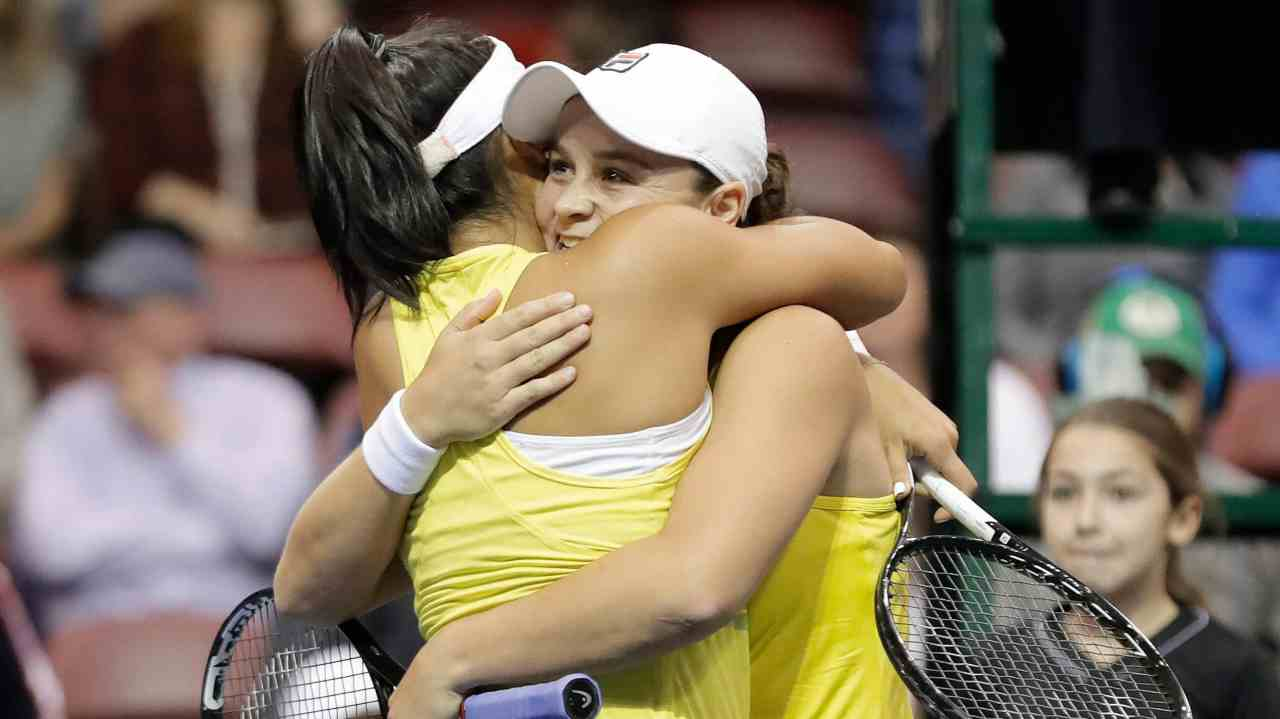 Australia's Ashleigh Barty, right, hugs teammate Priscilla Hon, left, after they defeated United States' Danielle Collins and Nicole Melichar in their first-round Fed Cup tennis match in Asheville, NC. (AP/PTI)