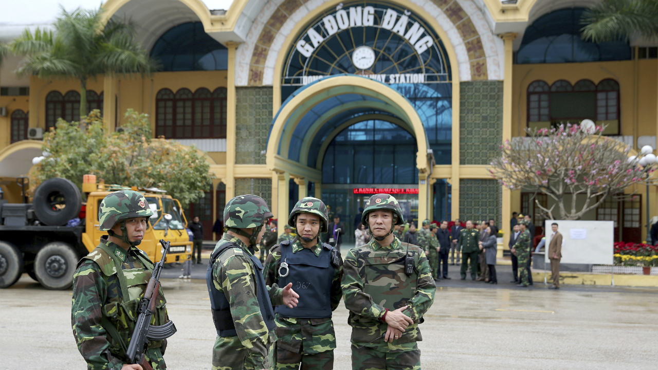 Vietnamese soldiers stand guard at the entrance to Dong Dang train station where North Korean leader Kim Jong Un is expected to arrive at the border town with China, in Lang Son province, Vietnam. (Image: AP)