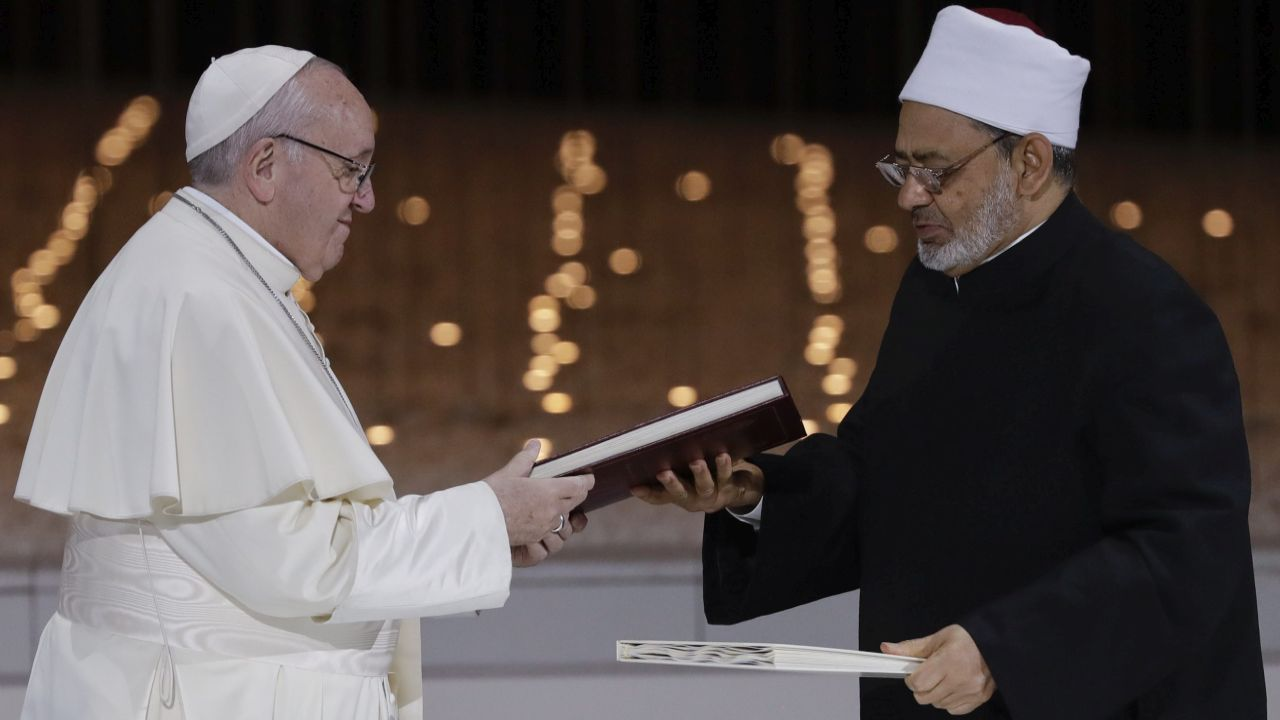 "Pope Francis, left, and Sheikh Ahmed el-Tayeb, the grand imam of Egypt's Al-Azhar, exchange a joint statement on ""human fraternity"" after an interfaith meeting at the Founder's Memorial in Abu Dhabi, United Arab Emirates. Pope Francis has asserted in the first-ever papal visit to the Arabian Peninsula that religious leaders have a duty to reject all war and commit themselves to dialogue. (AP/PTI)"