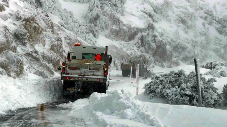 The image shows snow clearing vehicles attempting to clear several feet of snow from California State Route 2, the Angeles Crest Highway, in the San Gabriel Mountains above Montrose in Southern California. (Image: AP/PTI)