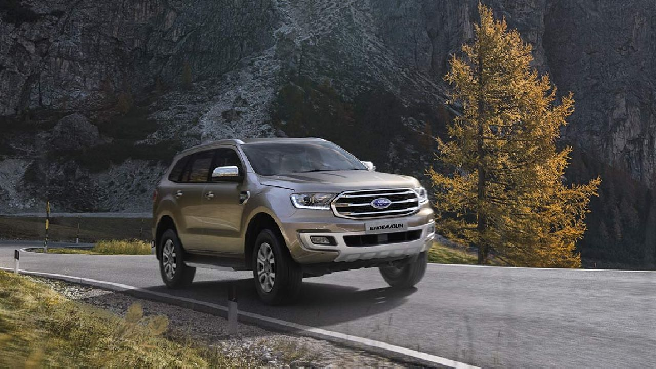 Ford India recently launched the latest iteration of its premium SUV, the 2019 Ford Endeavour. Along with a facelift and fresh looks, the Endeavour has undergone many changes and received some timely updates. One of the most prominent changes in the SUV is the redesigned front bumper, whose chrome plated trapezoidal grille makes a bold statement. Both the fenders have integrated skid plates which protect the car's underbelly on all terrains. The Endeavour also gets new 18-inch alloy wheels which gives an improved grip and stability.