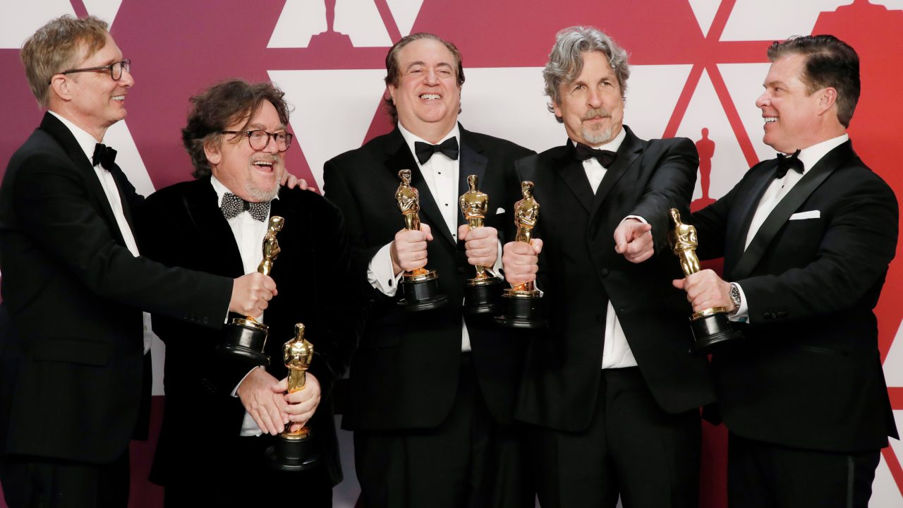 """Green Book"" producers Jim Burke, Charles Wessler, Nick Vallelonga, Peter Farrelly and Brian Hayes Currie pose backstage with their Best Picture awards. (Image: Reuters)"