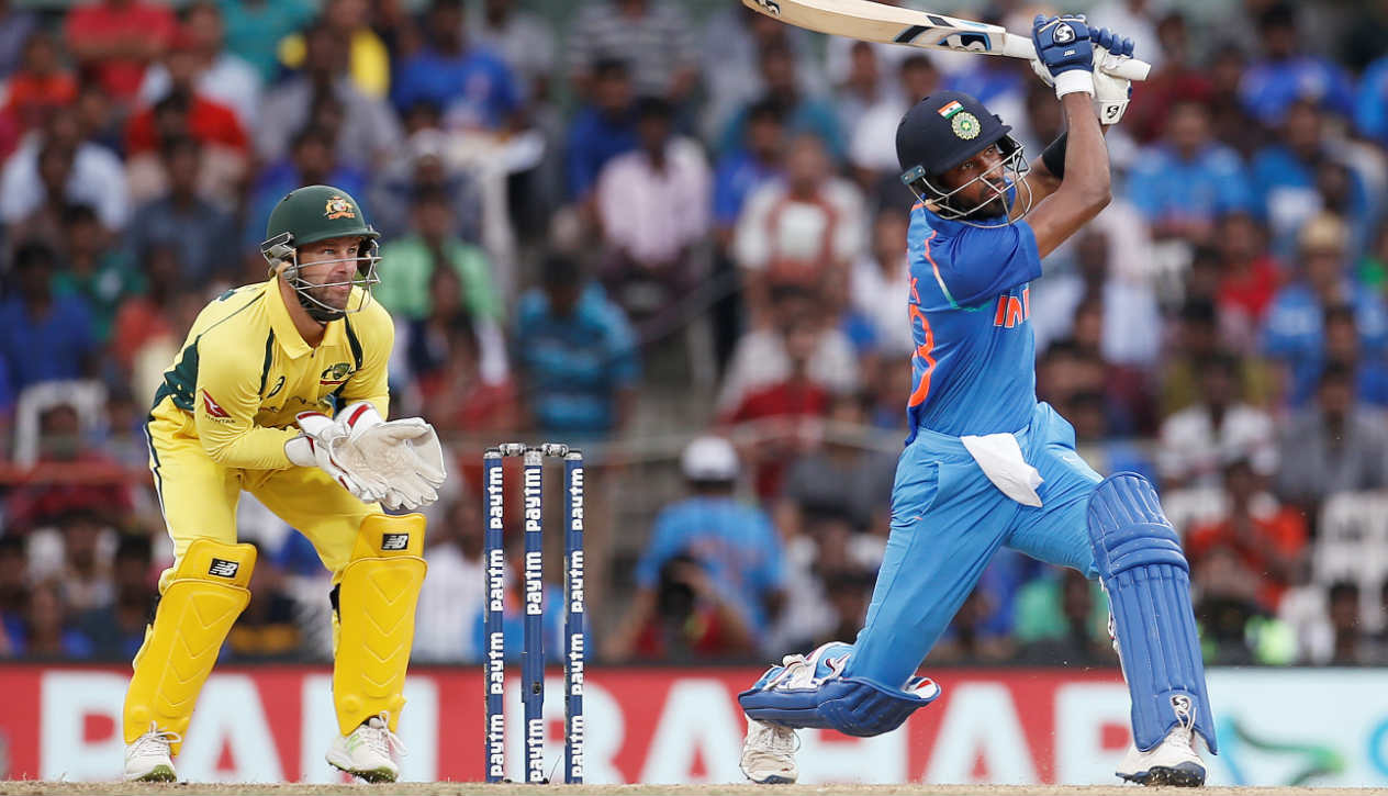 Hardik Pandya India v Australia, 1st ODI ,September 17 2017 Chennai | India were batting first. Pace duo of Nathan Coulter-Nile and Marcus Stoinis had reduced India to a precarious 87/5 inside 22 overs. Adam Zampa, the Aussie leg spinner, stepped up to bowl the 37th over of the Indian innings. MS Dhoni was on strike. Dhoni played the first ball to off-side and took a single. The strike was now with Hardik Pandya. The second ball was a full toss which Pandya dispatched for a boundary towards mid-on. Zampa tossed the third delivery and Pandya got under the ball to hoist it down the ground. The ball sailed over long-off for the first six of the over. The third ball of the over was a floater on middle stump and the Indian all-rounder unleashed the full wrath of his bat to send the ball soaring over long-on for the second six of the over. The six completed Pandya's fifty. Under pressure, Zampa bowled fifth ball quick and flat. Pandya cleared his front leg and deposited the ball over long-on to complete the hat-trick of sixes. Pandya played the last ball for a single. The Indian all-rounder's late assault meant he made 83 off 66 balls and India posted 281/7. Pandya shone with the ball too picking up two wickets. India won the match 26 runs and Pandya won the Player of the Match award for his effort. (Image: Reuters)