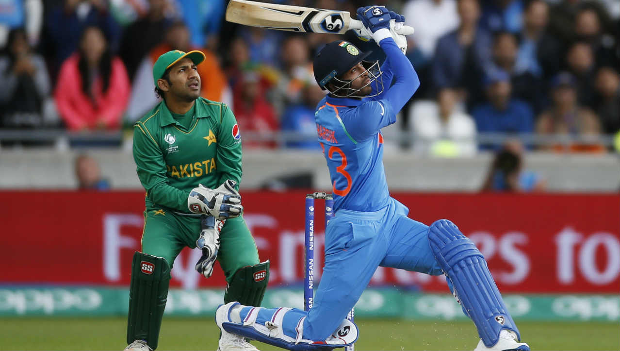 India v Pakistan, Champions Trophy, June 4 2017, Birmingham | India and Pakistan clashed a few days before the final of the Champions Trophy in the group stage of the tournament. India batted first. Pandya had just walked out to bat with his team cruising at 296/3 in 47 overs. At the other end was Virat Kohli who had smashed 77 in 67 balls. Imad Wasim was given the responsibility to bowl the last over. First ball was full on off-stump to which Pandya cleared his front leg and launched it high over long-off. Second ball was again full and on Pandya slapped the ball over wide long-off for a flat batted six. Under pressure, Wasim pulled the length back for the third ball and aimed the ball on the off-stump. Pandya shuffled across, went down on one knee to hammer the ball over deep mid-wicket to complete three sixes in as many deliveries. Fourth ball was a dot. Pandya took a single on fifth ball and Kohli smashed the last ball for a boundary. Pandya's last over onslaught propelled India to 319/3. Pandya scalped two wickets as Pakistan were sent packing on mere 164. (Image: Reuters)