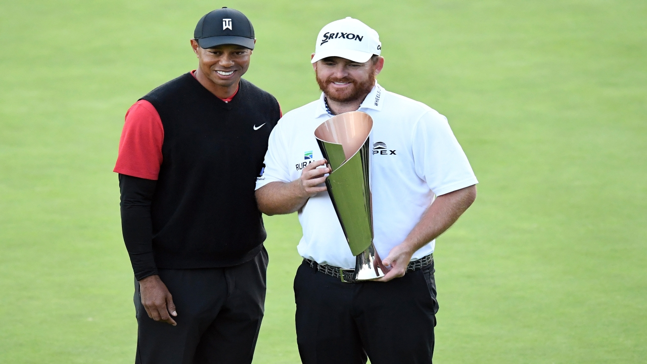 J.B. Holmes poses for photos with Tiger Woods following his victory of the Genesis Open golf tournament at Riviera Country Club. (Image: Reuters)
