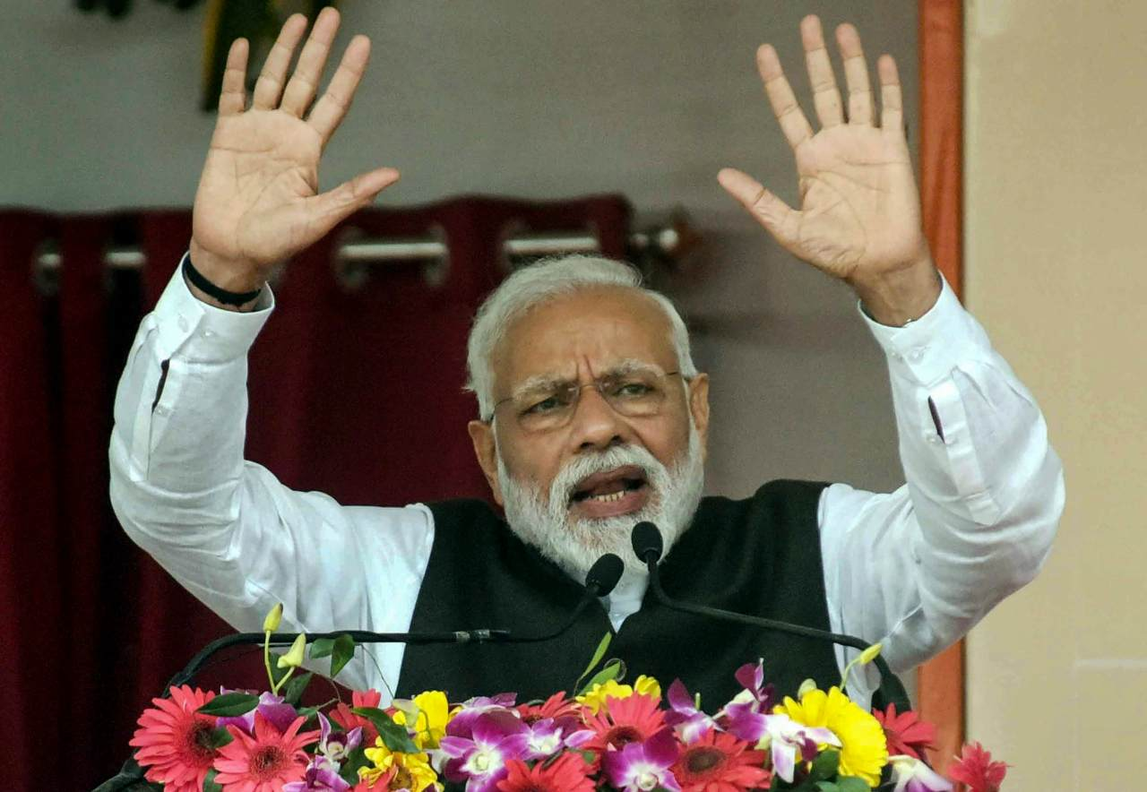 Prime Minister Narendra Modi addresses the inauguration and foundation stone-laying ceremony of various development projects, in Begusarai Bihar. (Image: PTI)