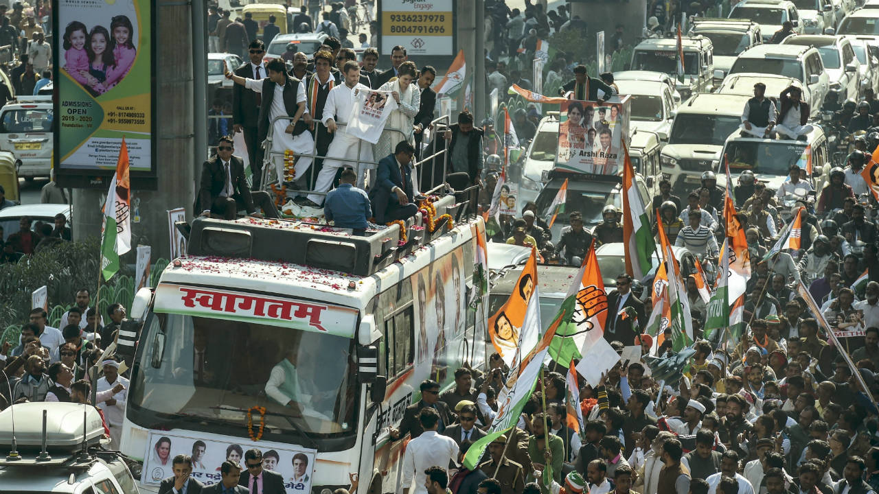 Congress President Rahul Gandhi, AICC General Secretaries Priyanka Gandhi Vadra and Jyotiraditya Scindia, among other senior leaders during a roadshow, in Lucknow, Uttar Pradesh. (Image: PTI)