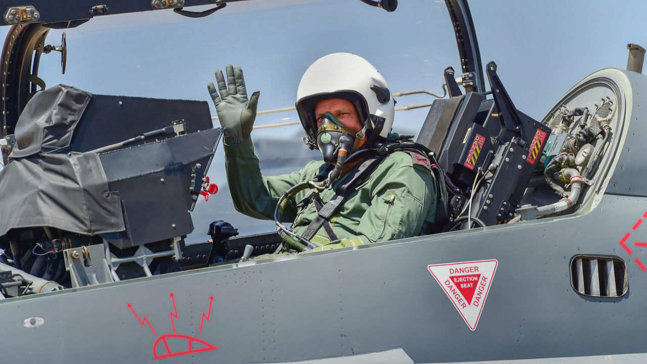 General Rawat sat behind the pilot in a two-seater trainer variant of the Tejas and took a sortie, a day after the HAL-made fighter jet received the Final Operational Clearance (FOC) at the air show, signalling that it was combat ready. (Image: PTI)