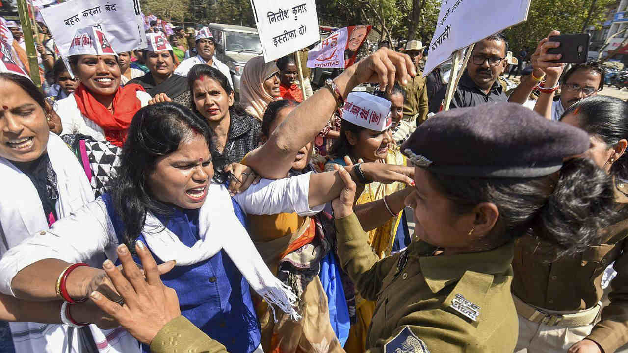 Police detain Hindustani Awam Morcha (Secular) (HAM-S) activists during their Raj Bhawan march against the Muzaffarpur shelter home rape case, in Patna. (PTI)