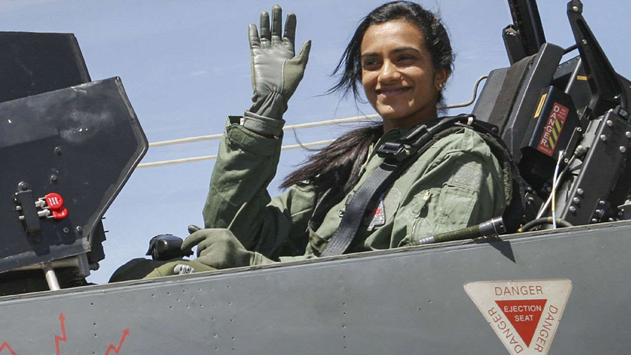 Badminton player PV Sindhu waves from the cockpit of twin-seater - HAL's Light Combat Aircraft (LCA) Tejas on the 4th day of 12th edition of AERO India 2019, at Yelahanka Air Base, in Bengaluru. (PTI)
