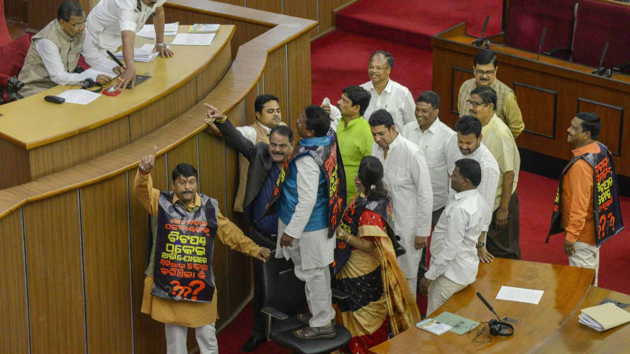 Congress and BJP MLA's raise slogans over the issue of chit fund scam during the Budget Session of Odisha Assembly, in Bhubaneswar. (PTI)