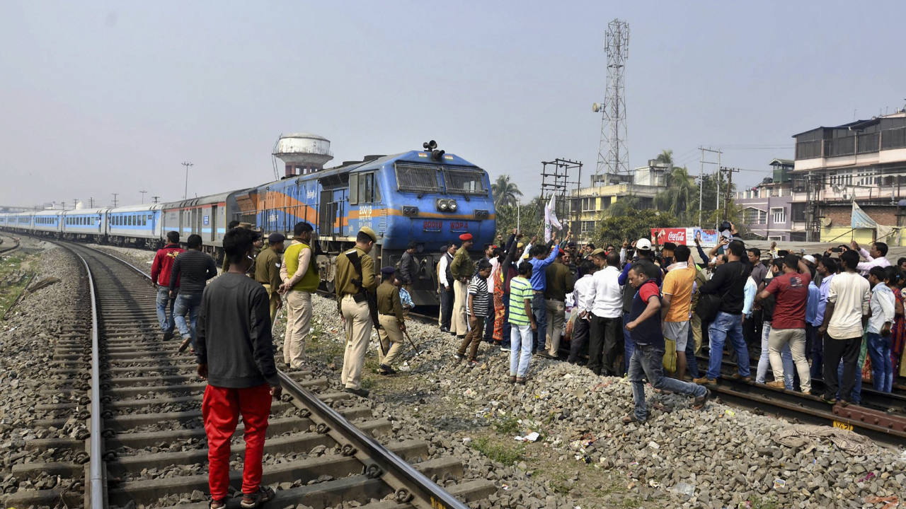 Assam Jatiyatabadi Yuva Chatra Parishad (AJYCP) member stop a train during a protest against Citizenship (Amendment) Bill near Kamakhya Junction railway station, in Guwahati, Assam. (Image: PTI)