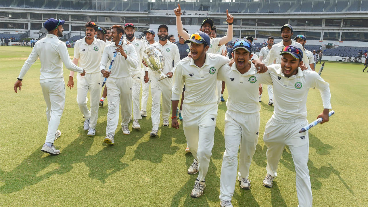 Vidarbha team players celebrate after defeating Saurashtra in the final cricket match of the Ranji Trophy 2018-19, in Nagpur, Maharashtra. Defending champions Vidarbha won the 85th Ranji Trophy title, beating Saurashtra by 78 runs in the summit clash. (Image: PTI)